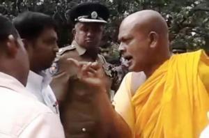 buddhist-monk-threatening-to-ki-300x198